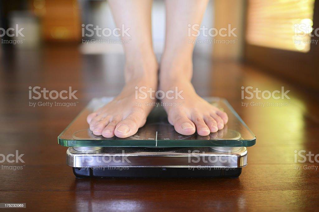 Standing On Weight Scale Standing On Weight Scale Adult Stock Photo