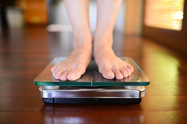 Standing On Weight Scale stock photo