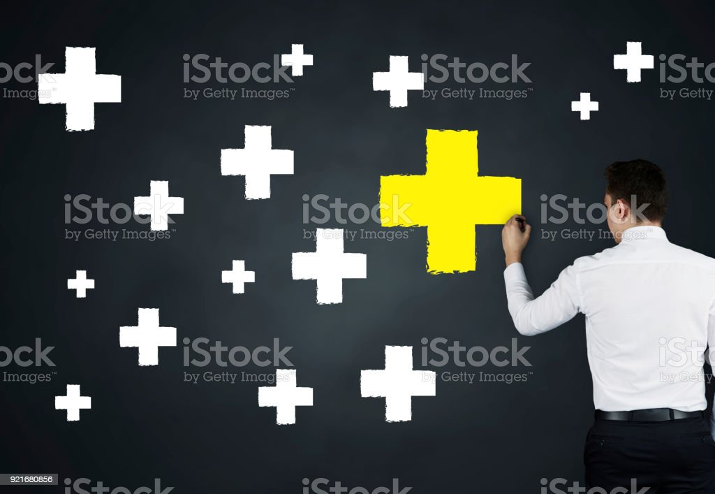 Standing Out From The Crowd Concept on Blackboard stock photo