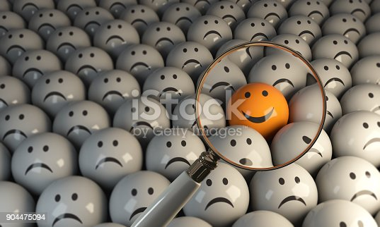 istock Standing Out From The Crowd Of Sad Faces 904475094