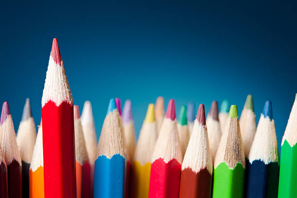standing out from the crowd - coloured pencil stock photos and pictures