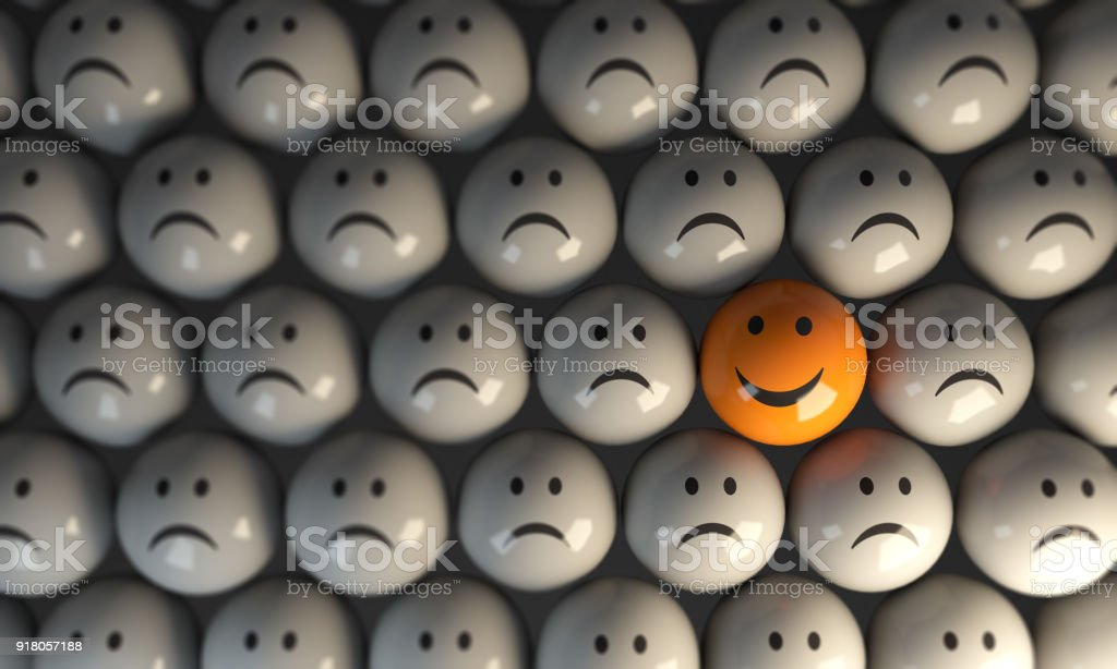 Standing Out From The Crowd With Happy Face stock photo