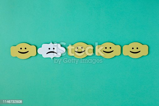 istock Standing Out From The Crowd With Paper 1146732508