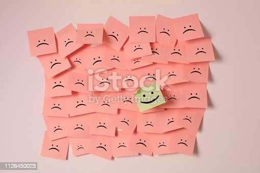 istock Standing Out From The Crowd With Smiling Hexagon 1126450023