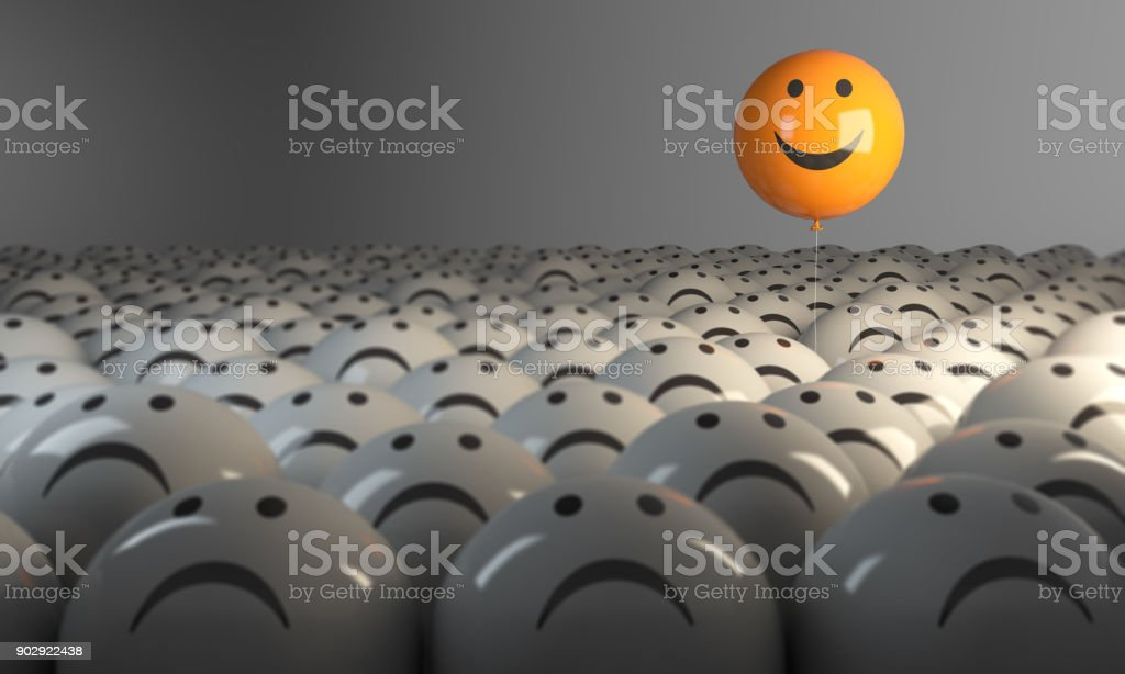 Standing Out From The Crowd With Smiling Sphere stock photo