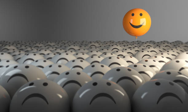 Standing Out From The Crowd With Smiling Sphere Smiling Sphere Balloon in the middle of grey crowd. ( 3d render )  negative emotion stock pictures, royalty-free photos & images