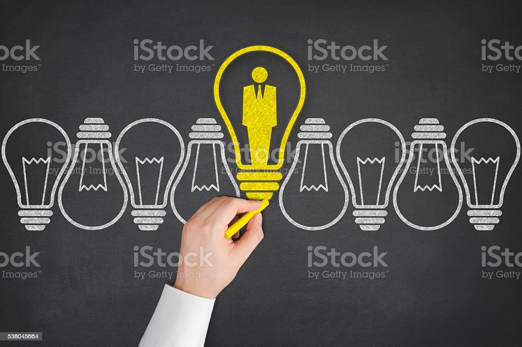Standing Out of the Crowd Idea with Light Bulbs stock photo
