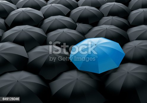 Unique and different blue umbrella standing out of the crowd from black ones