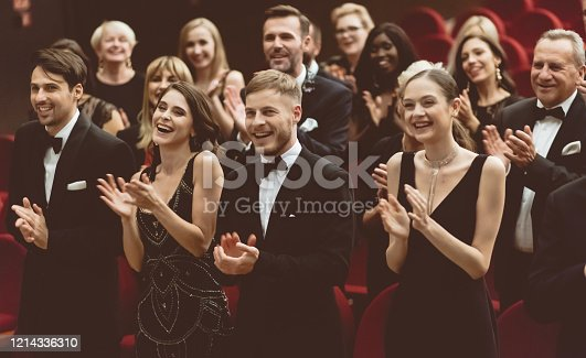 483876497 istock photo Standing ovation in the theater 1214336310