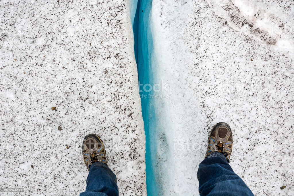Standing over a crevice stock photo