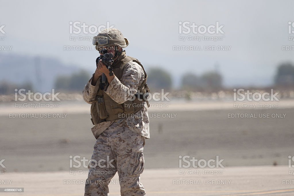 Standing Soldier Aiming Rifle royalty-free stock photo