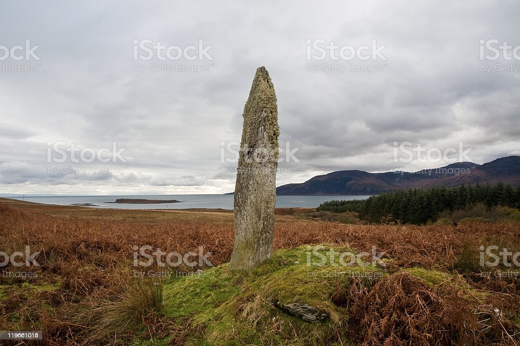Standing stone and field stock photo