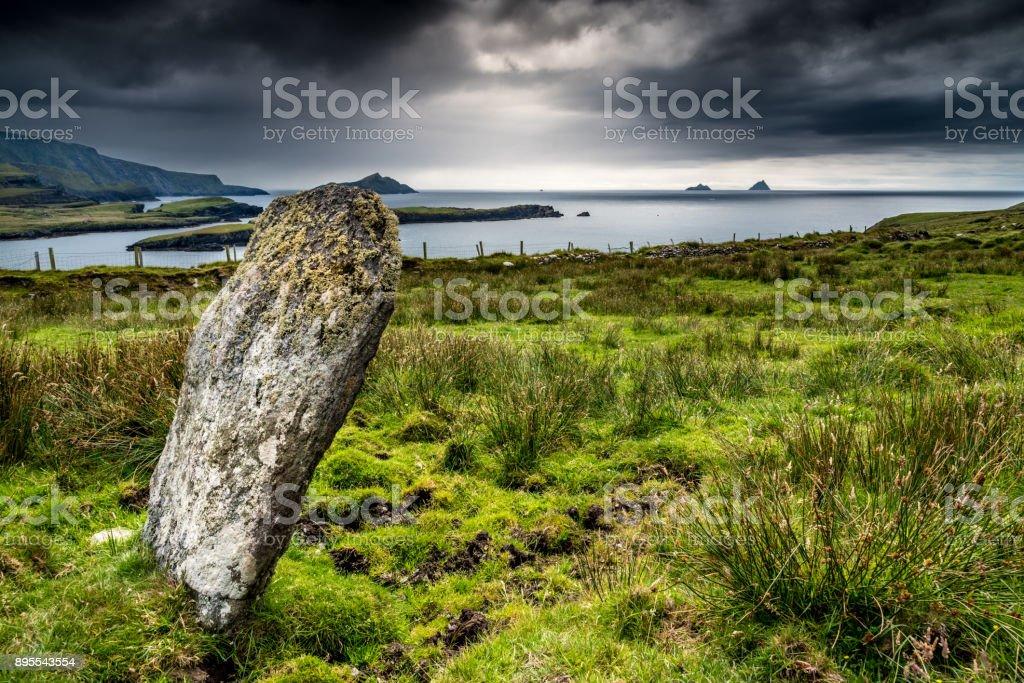 Standing stone on the coast of Ireland stock photo