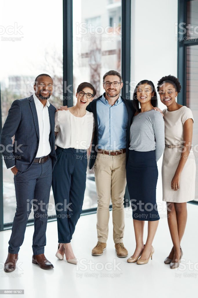 Standing tall and together as leaders of the industry stock photo