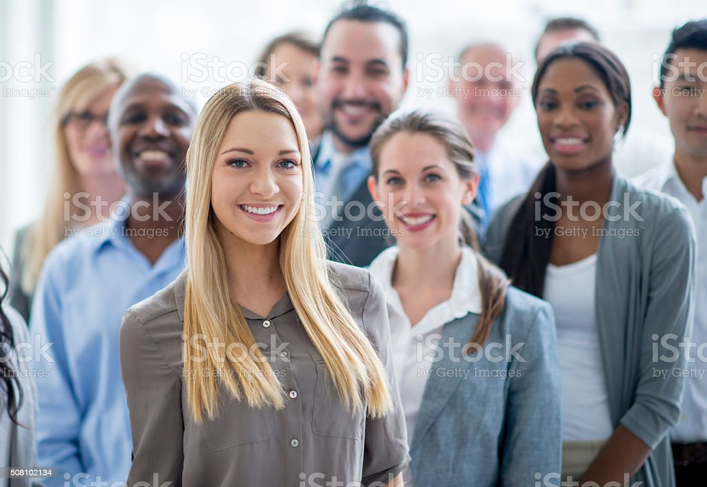 Standing Together Happily at Work stock photo