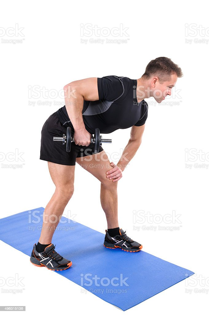 Standing Triceps Extension Dumbbell Workout stock photo