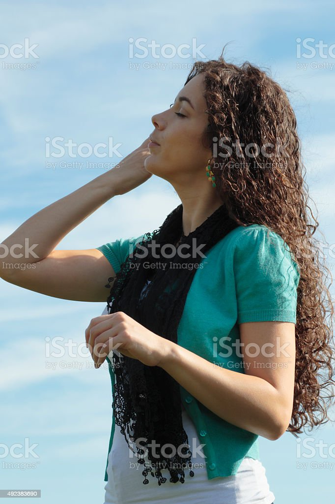 Outlined against sky beautiful shapely Canadian outdoor girl stock photo