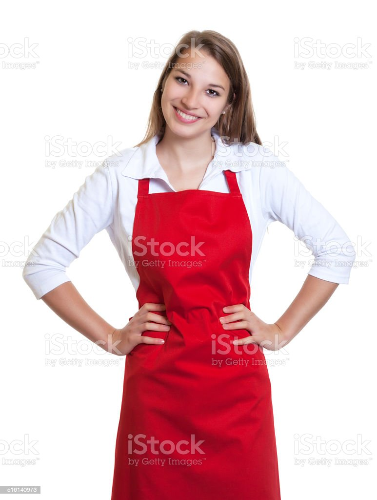 Standing waitress with red apron and crossed arms stock photo