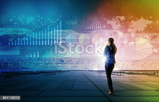 istock standing woman who looks various graphics of business. Internet of Things. Information Communication Technology. Digital transformation. Abstract mixed media. 824126220