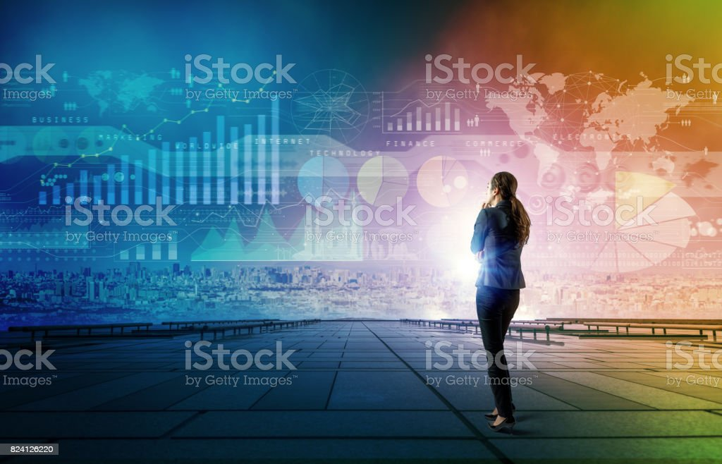 standing woman who looks various graphics of business. Internet of Things. Information Communication Technology. Digital transformation. Abstract mixed media. stock photo