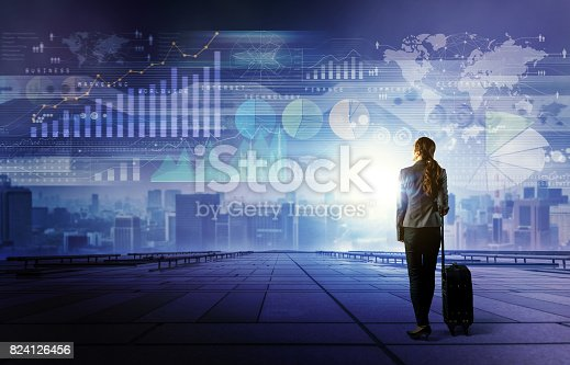 istock standing woman who looks various graphics of business. Internet of Things. Information Communication Technology. Digital transformation. Abstract mixed media. 824126456