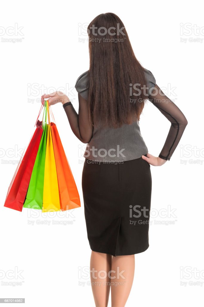 Standing Woman With Shopping Bags. Backside View. Isolated Over White stock photo