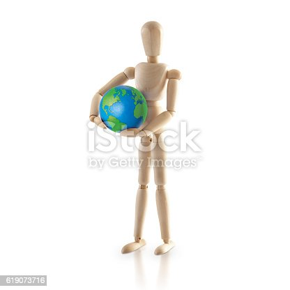 istock Standing Wood model carry the world 619073716