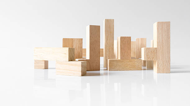 Standing wooden block puzzle of various shapes on empty background Standing wooden block puzzle of various shapes on empty background. Concept of creative building. Slightly de-focused and close-up shot. Copy space. disjointed stock pictures, royalty-free photos & images