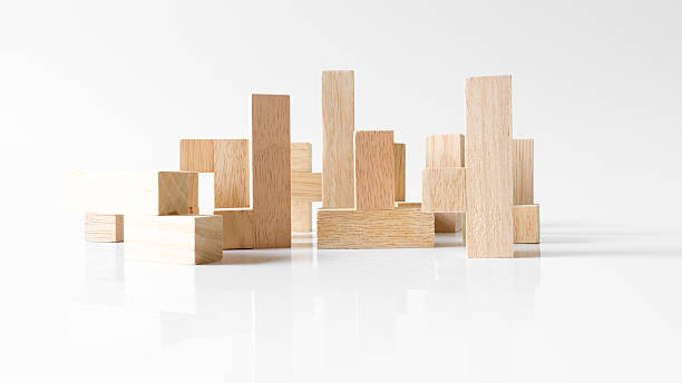 Standing wooden block puzzle of various shapes Standing wooden block puzzle of various shapes on empty background. Concept of creative building. Slightly de-focused and close-up shot. Copy space. disjointed stock pictures, royalty-free photos & images