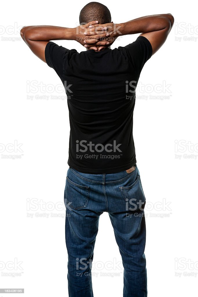 Standing Young Man With Hands Clasped Behind Head, Rear View stock photo