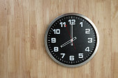 Standless Clock on Wooden Background, 8 O'Clock