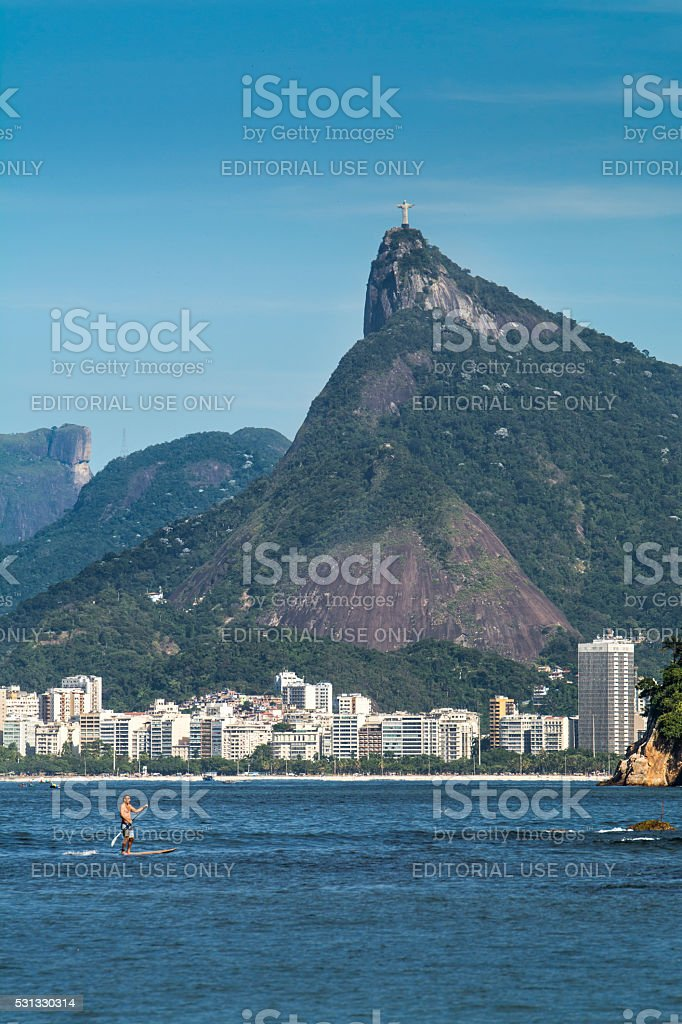 Stand-up paddle and Christ the Redeemer stock photo