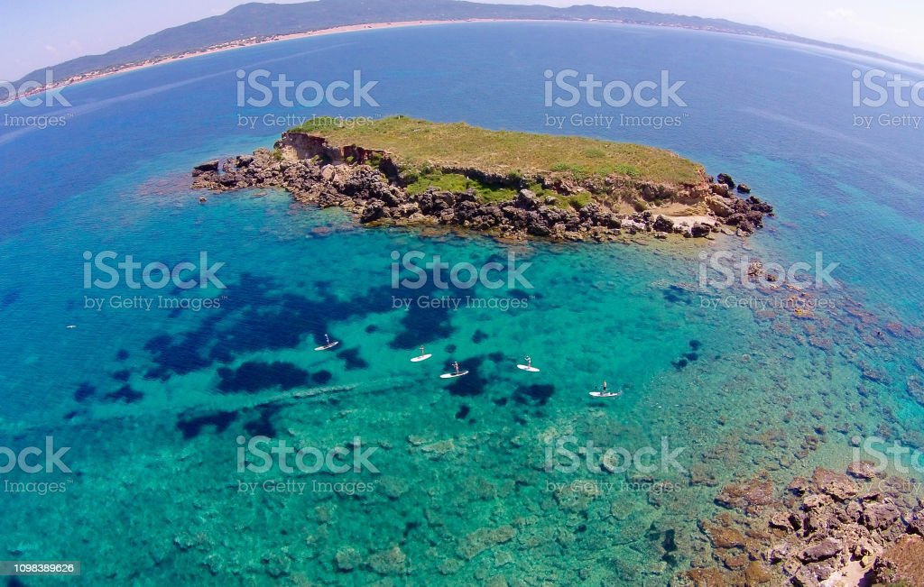 Stand-up Paddle Boarders near Lagoudia Island stock photo
