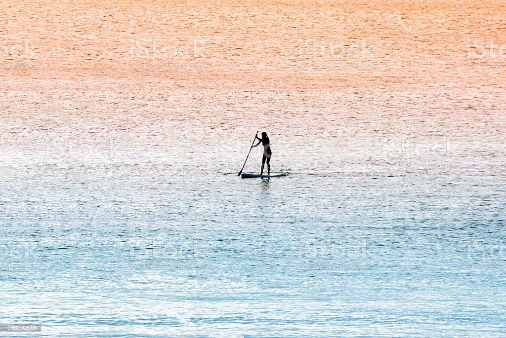 Standup paddle surfer girl stock photo