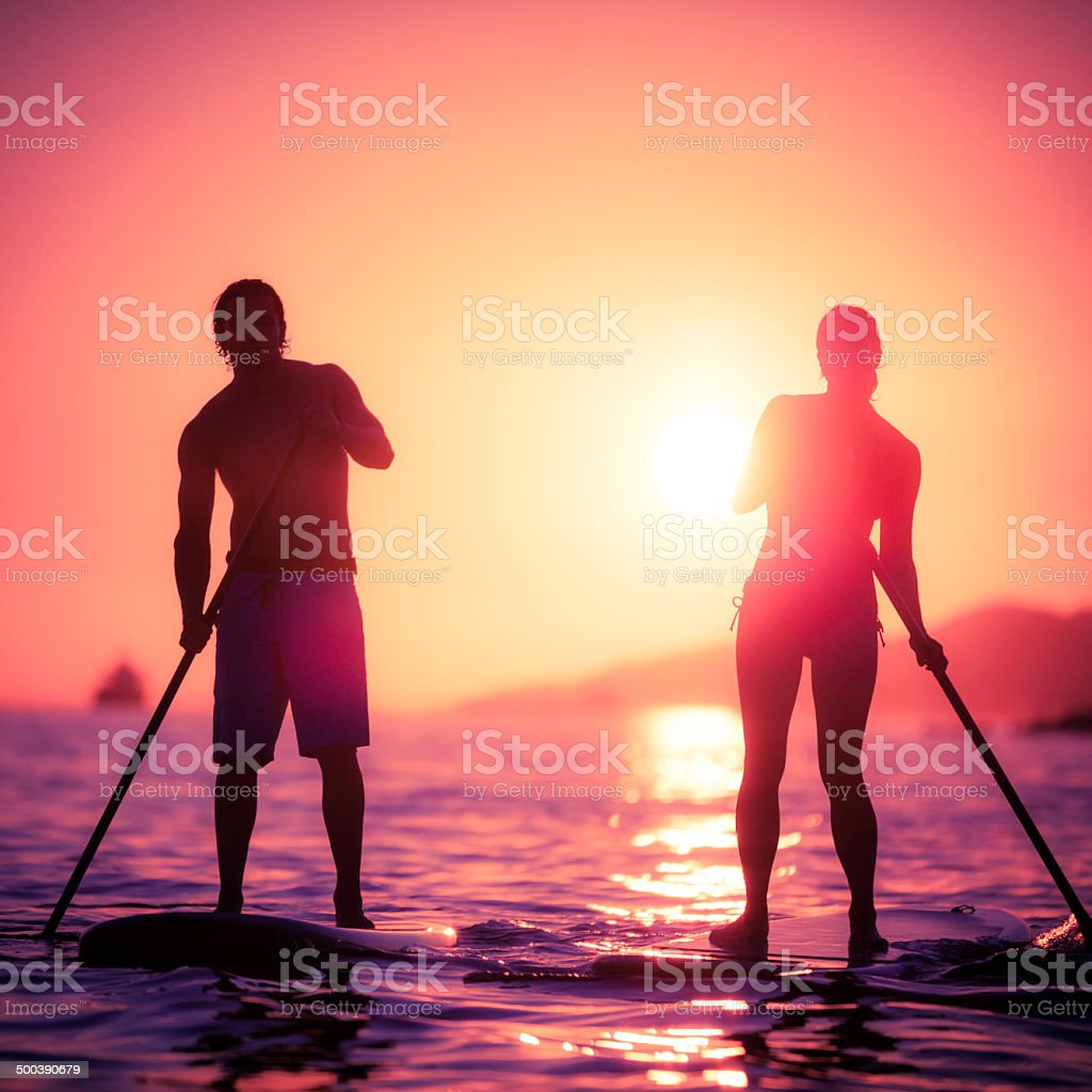 Standup Paddleboarding at Sunset stock photo