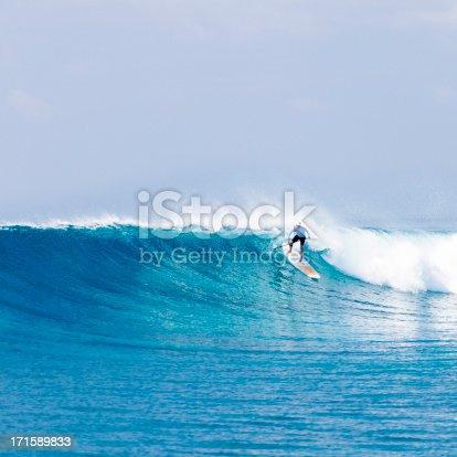 Standup paddler riding wave