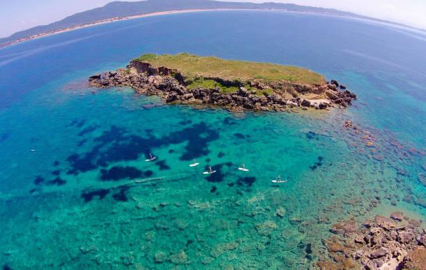 Stand-up Paddlers near Lagoudia Island, Corfu, Greece stock photo