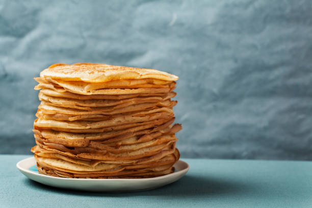 Staple of yeast pancakes, traditional for Russian pancake week stock photo