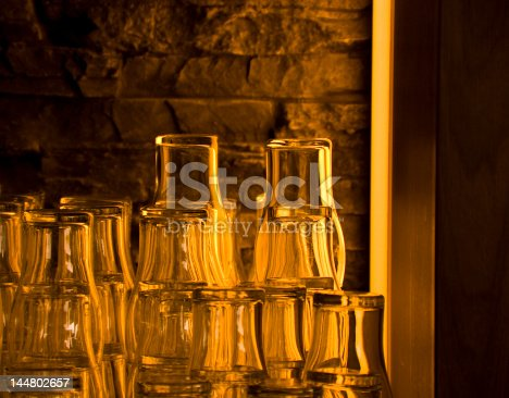 1013514594 istock photo Stapled glass dishware in restaurant 144802657
