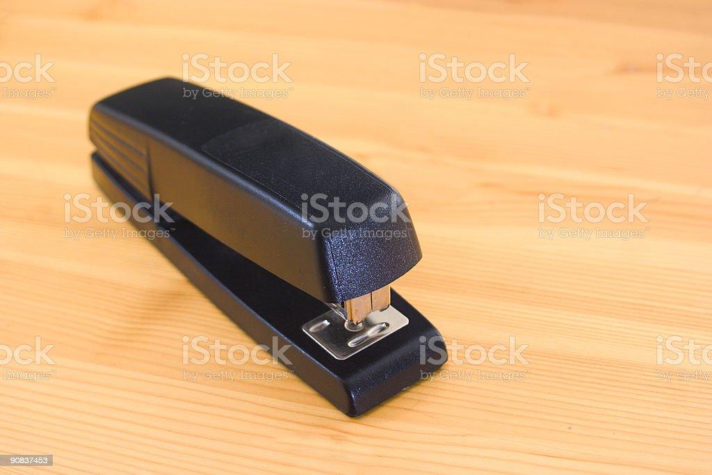 Stapler on wood stock photo