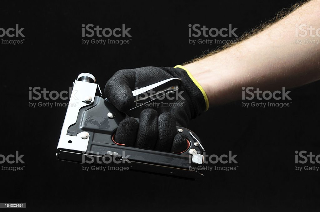 Stapler Pliers and a Hand royalty-free stock photo