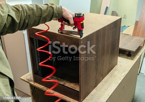 Staples, for a pneumatic stapler, in a carpentry workshop, workflow, close-up