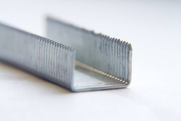 Staples for a stapler on a white background close-up. macro Staples for a stapler on a white background close-up. macro detach stock pictures, royalty-free photos & images