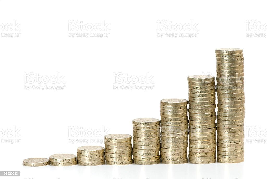 Staples of coins symbolizing growth of profit royalty-free stock photo