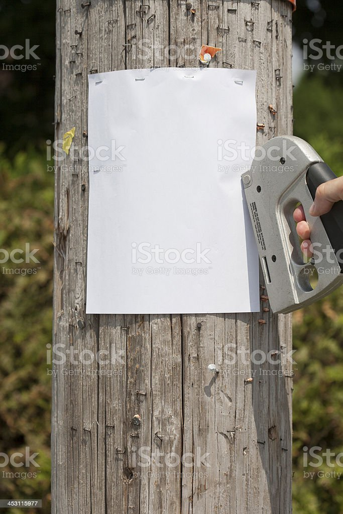 stapling a blank sign stock photo