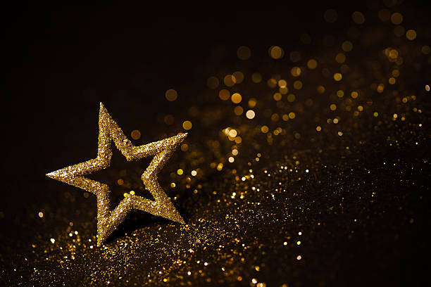 star abstract decoration lights, gold sparkles, blurred shine background - star shape stock photos and pictures