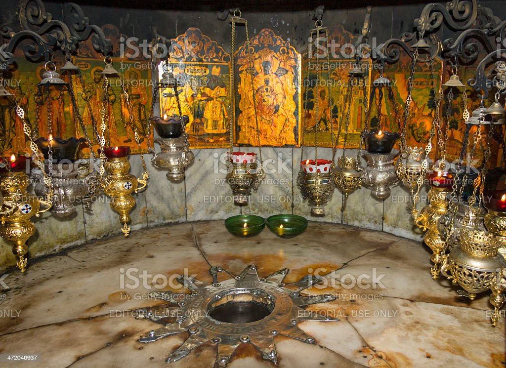 Star and icon-lamps  in Nativity Grotto over Jesus Christ birthplace stock photo