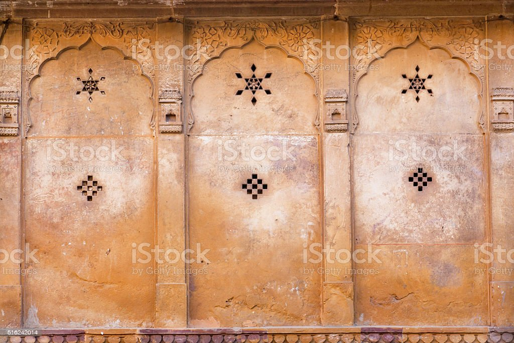 Star and other symbols on the ancient wall stock photo