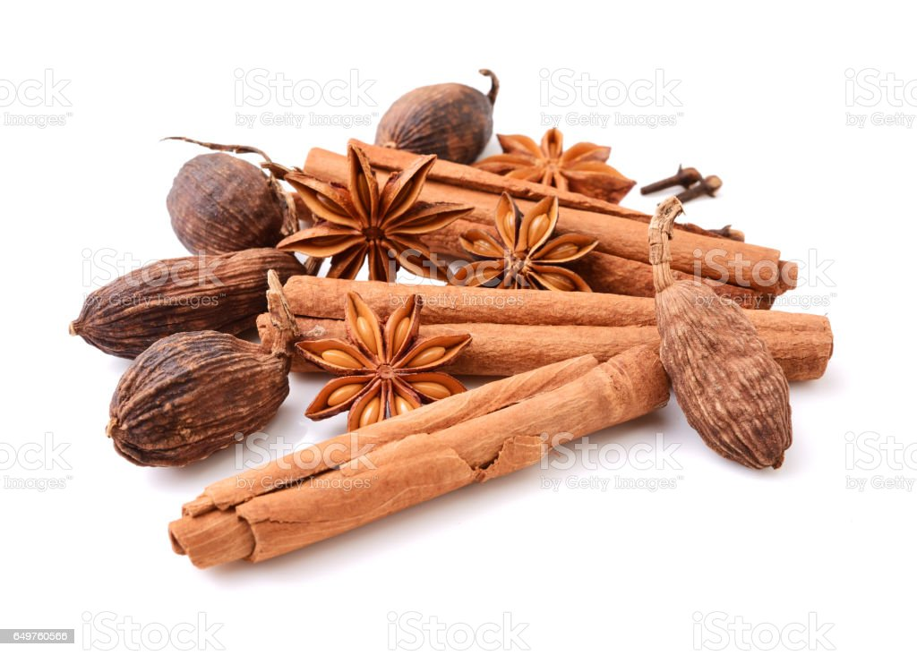 Star anise, cinnamon sticks, black cardamom pods,  on a white background stock photo