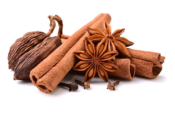 star anise, cinnamon sticks, black cardamom pods, Various seasonings on white background star anise on white stock pictures, royalty-free photos & images
